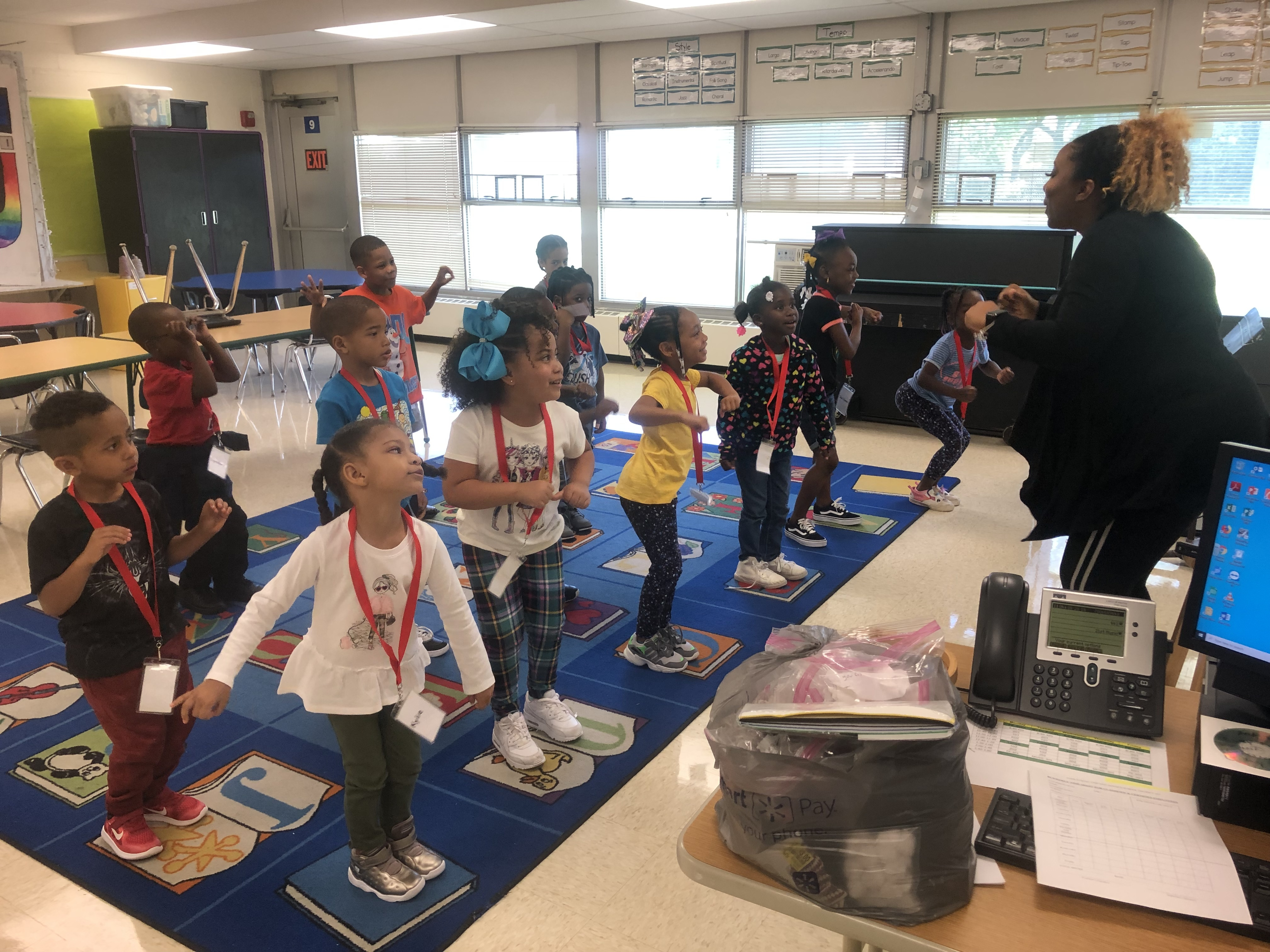 "Kindergarten engaging in movement singing the ""Bubble Game"" song during performing arts class with Ms. Chatman"